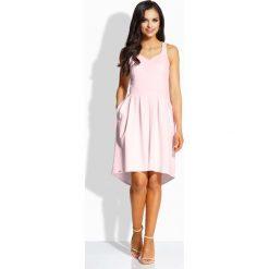 Różowa Kobieca Sukienka na Szerokich Ramiączkach. Różowe sukienki balowe marki numoco, l, z dekoltem w łódkę, oversize. Za 95,90 zł.