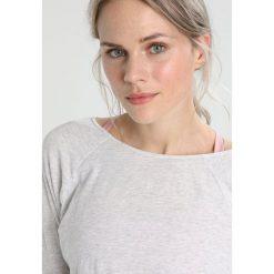 Manduka ADORN CROSS BACK Bluzka z długim rękawem heather grey. Szare bluzki damskie Manduka, xl, z bawełny, z długim rękawem. Za 229,00 zł.