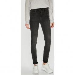 Levi's - Jeansy 721. Brązowe jeansy damskie rurki marki Levi's®, z bawełny, z podwyższonym stanem. Za 399,90 zł.