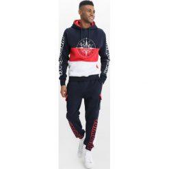 Spodnie dresowe męskie: Cayler & Sons BLOCKED Spodnie treningowe navy/red