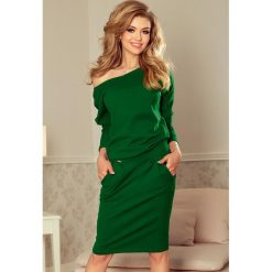 Heidi Sukienka dresowa z dekoltem na plecach - ZIELEŃ BUTELKOWA. Szare długie sukienki marki bonprix, melanż, z dresówki, z kapturem, z długim rękawem. Za 139,00 zł.