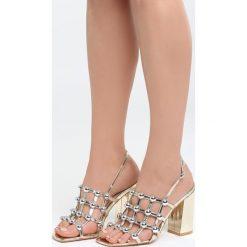 Złote Sandały Chubby Cheeks. Żółte sandały damskie na słupku marki Born2be, z lakierowanej skóry, na wysokim obcasie. Za 89,99 zł.