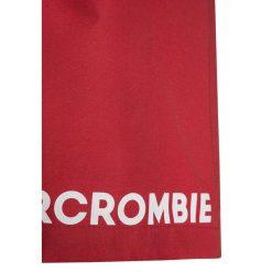 Abercrombie & Fitch CORE Szorty kąpielowe red/navy. Niebieskie kąpielówki chłopięce Abercrombie & Fitch, z materiału. W wyprzedaży za 125,10 zł.