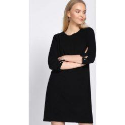 Czarna Sukienka Another Star. Czarne sukienki hiszpanki Born2be, l, retro, midi, oversize. Za 79,99 zł.