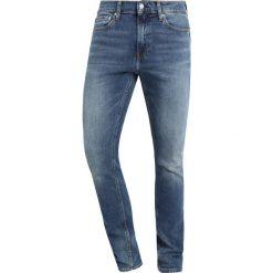 Calvin Klein Jeans 026 SLIM Jeansy Slim Fit blue denim. Niebieskie jeansy męskie relaxed fit Calvin Klein Jeans. Za 419,00 zł.