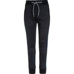 Tumble 'n dry BODI Spodnie treningowe night blue. Niebieskie jeansy chłopięce Tumble 'n dry. W wyprzedaży za 125,30 zł.