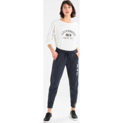 Spodnie dresowe damskie: Abercrombie & Fitch CHAIN JOGGER Spodnie treningowe navy