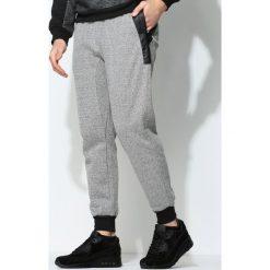 Szare Spodnie Dresowe True Match. Czarne spodnie dresowe męskie marki Born2be, l, z aplikacjami, z dresówki. Za 59,99 zł.
