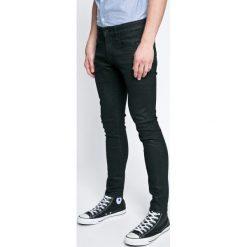 G-Star Raw - Jeansy. Szare jeansy męskie slim marki G-Star RAW, z bawełny. W wyprzedaży za 379,90 zł.