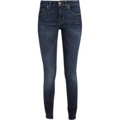 Tiger of Sweden Jeans SLIGHT Jeans Skinny Fit blue denim. Czerwone rurki damskie marki Selected Femme, z bawełny. Za 629,00 zł.