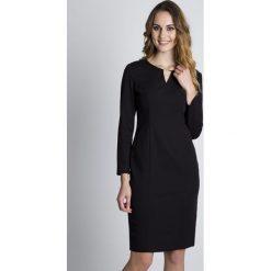Sukienki: Czarna dopasowana sukienka z długim rękawem BIALCON