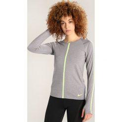 Nike Performance Koszulka sportowa gunsmoke/heather/volt. Szare topy sportowe damskie Nike Performance, l, z elastanu. W wyprzedaży za 153,30 zł.