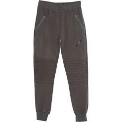 Ciemnozielone Spodnie Dresowe Tie the Best. Czarne spodnie dresowe męskie marki Born2be, l, z aplikacjami, z dresówki. Za 44,99 zł.
