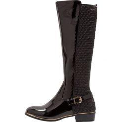 Dorothy Perkins TINA Kozaki black. Czarne buty zimowe damskie Dorothy Perkins, z materiału. W wyprzedaży za 147,95 zł.