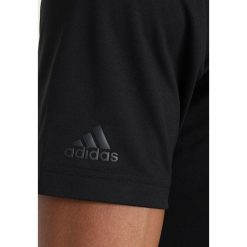 Adidas Golf ADIDAS PERFORMANCE  Koszulka polo black. Czarne koszulki sportowe męskie adidas Golf, m, z materiału, na golfa. Za 189,00 zł.
