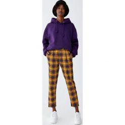 Spodnie skinny w kratkę. Żółte rurki damskie Pull&Bear, w kratkę. Za 79,90 zł.