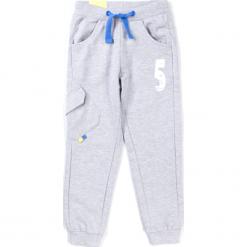 Spodnie. Niebieskie chinosy chłopięce TRUCK, z bawełny. Za 29,90 zł.