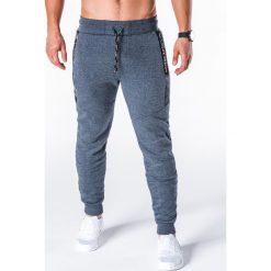 SPODNIE MĘSKIE DRESOWE P656 - GRANATOWE. Niebieskie spodnie dresowe męskie marki Ombre Clothing, z bawełny. Za 55,00 zł.