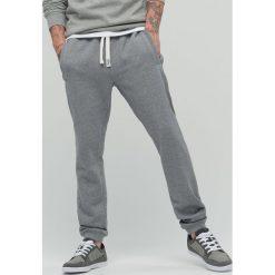Spodnie dresowe męskie: Dresowe spodnie – Jasny szary