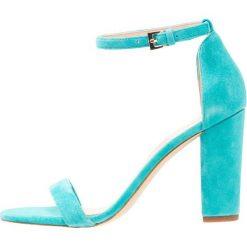 ALDO MYLY Sandały na obcasie turquoise. Niebieskie sandały damskie ALDO, z materiału, na obcasie. Za 359,00 zł.