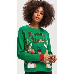 Sweter ze świątecznym motywem - Zielony. Zielone swetry klasyczne damskie Reserved, l. Za 79,99 zł.