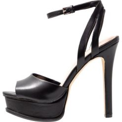ALDO EOWELASSA Sandały na obcasie black. Czarne sandały damskie ALDO, z materiału, na obcasie. Za 359,00 zł.