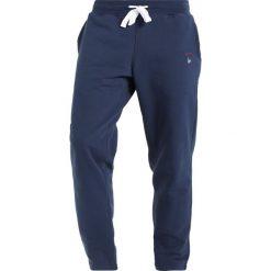 Spodnie dresowe męskie: Orsman GUIDE TRACK PANTS Spodnie treningowe navy