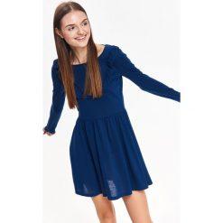 SUKIENKA DAMSKA Z OZDOBNĄ FALBANĄ. Niebieskie sukienki balowe marki Top Secret, na jesień. Za 44,99 zł.