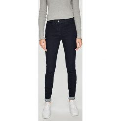 Calvin Klein - Jeansy. Niebieskie jeansy damskie marki Calvin Klein, z bawełny. Za 399,90 zł.