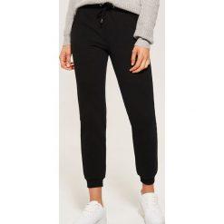 Dresowe joggery - Czarny. Czarne spodnie dresowe męskie House, z dresówki. Za 59,99 zł.