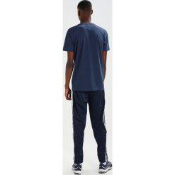 Spodnie męskie: Ellesse BRIZZI Spodnie treningowe dress blues