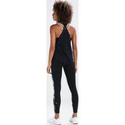 Under Armour STRAPPY Koszulka sportowa black. Czarne topy sportowe damskie marki Under Armour, xs, z bawełny. W wyprzedaży za 135,85 zł.