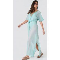 NA-KD Boho Zdobiona sukienka typu kaftan - Green. Niebieskie sukienki boho marki NA-KD Boho, na imprezę, w koronkowe wzory, z koronki, na ramiączkach, mini. Za 161,95 zł.