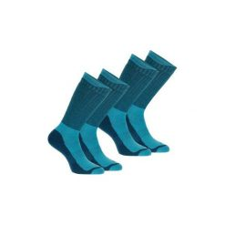 Skarpety turystyczne SH500 ultra-warm mid. Niebieskie skarpetki męskie marki QUECHUA, z elastanu. Za 49,99 zł.