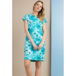 Tuniki damskie na lato: Lniana tunika w kwiaty
