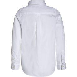 Lacoste Koszula white. Szare bluzki dziewczęce bawełniane marki Lacoste. Za 279,00 zł.