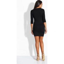 Sukienki balowe: Kobieca elegancka sukienka ze splotem czarna