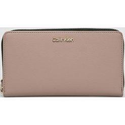 Calvin Klein - Portfel. Brązowe portfele damskie Calvin Klein, z materiału. Za 269,90 zł.