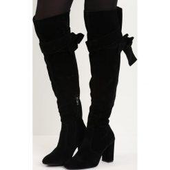 Czarne Kozaki Mayon. Czarne buty zimowe damskie Born2be, na wysokim obcasie, na słupku. Za 159,99 zł.