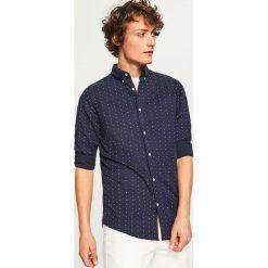 Koszula z mikroprintem slim fit - Granatowy. Niebieskie koszule męskie slim marki Reserved, l. Za 99,99 zł.