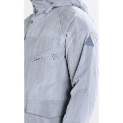 Burton BREACH Kurtka snowboardowa la sky distress. Niebieskie kurtki sportowe męskie Burton, m, z materiału, snowboardowy. W wyprzedaży za 775,20 zł.