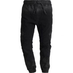 Tigha BOLON Bojówki vintage black. Czarne bojówki męskie Tigha, z bawełny. Za 629,00 zł.