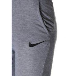 Nike Performance DRY PANT TAPER Spodnie treningowe multicolor. Szare spodnie chłopięce Nike Performance, z materiału. Za 159,00 zł.