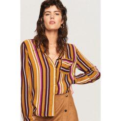 Koszula we wzory - Wielobarwn. Brązowe koszule damskie marki Reserved. W wyprzedaży za 49,99 zł.