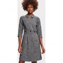 Elegancka sukienka - Wielobarwn. Czarne sukienki balowe marki Reserved. Za 199,99 zł.