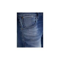 Jeansy slim fit Jack   Jones  VAQUERO  JJICLARK JJORIGINAL JOS 318 NOOS. Niebieskie jeansy męskie relaxed fit marki Jack & Jones. Za 316,60 zł.