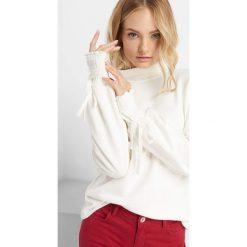 Lekki sweter z półgolfem. Czarne swetry oversize damskie marki KIPSTA, m, z elastanu, z długim rękawem, na fitness i siłownię. Za 89,99 zł.