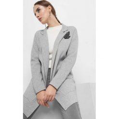 Kardigan z koralikami. Czarne kardigany damskie marki Orsay, xs, z bawełny, z dekoltem na plecach. Za 139,99 zł.
