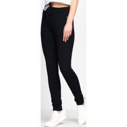Spodnie dresowe damskie: Granatowe Spodnie Dresowe Conformity