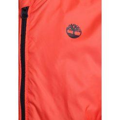 Timberland BLOUSON Kurtka Bomber orange. Brązowe kurtki męskie bomber marki Timberland, z materiału. W wyprzedaży za 271,15 zł.